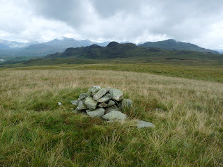 Slightly further on is another smaller cairn which seems slightly higher than the first one I visited. Again Green Crag is in the distance and Harter Fell behind.