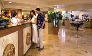 Checking in at Tradewinds Hotel Image