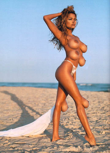 Girl on beach with six breasts