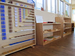 """The Montessori math curriculum alone is worth the investment in a Montessori preschool education! These shelves hold the keys to your child's love of math. For example, the bead chains on the left help preschoolers to skip count, and to understand the meaning of """"square"""" and """"cube"""" numbers."""