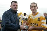 Paul Curran presents the O Duffy Cup to Clontibret team captain Brian McSkeane following Clontibret's win over Castleblayney . ©movingimages.ie