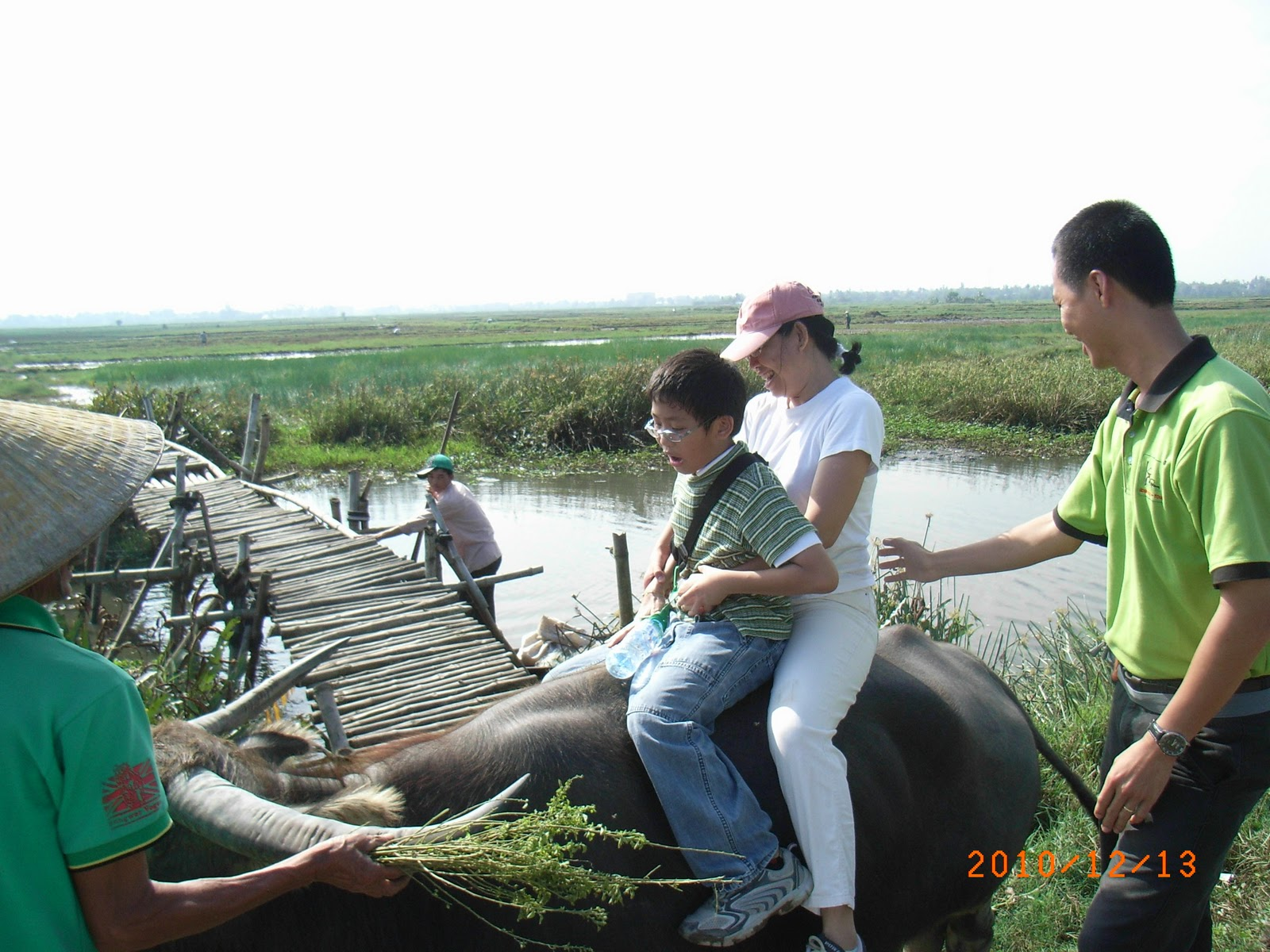 Susan andPaxton riding the water Buffalo