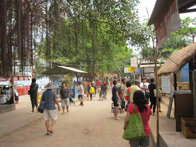 "The main ""street"" in Gili T. Not exactly the quiet, tranquil island we were imagining."