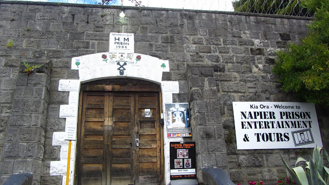 "Napier Prison's front gate. It appears they substituted the word ""Entertainment"" for ""Backpackers"" after closing down the hostel."