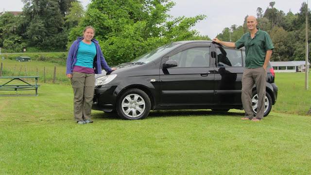 Standing next to our Jucy rental at our first campsite in Waitomo.