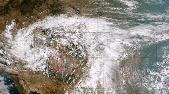 This image from the Suomi NPP satellite's VIIRS sensor from the evening of September 11, 2013, shows the storm system that has devastated towns in the foothills of the Rockies in central Colorado. Flash Flood Watches and Warnings are in effect throughout central Colorado, citing excessive runoff causing flash flooding of creeks and streams, roads and roadside culverts. The heavy rains could also trigger rock slides or debris flows in steep terrain. Major amounts of rain over the last several days have saturated soils in many foothill and Urban Corridor locations and additional rainfall in these locations today and tonight will only exacerbate an already serious situation. The High Park and Four Mile burn areas will be especially susceptible to the heavy rains. This image was taken around 2015Z on September 11, 2013. (NOAA)