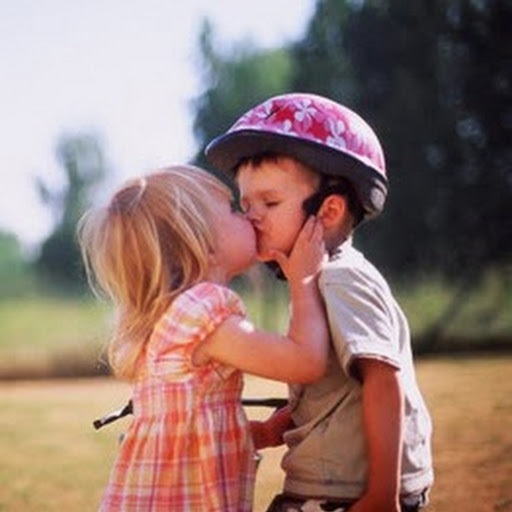 Little Boy and Girl Kissing