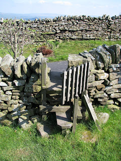 A very quaint stile and gate - out of a garden