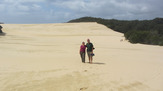 Walking across the sand dunes. There were a series of poles to follow so you wouldn't get lost.