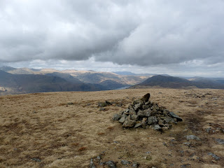 Gray Crag Summit. Ullswater can just be seen in the distance.