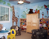 """Muhammad Playroom 2 of 2 - The mural in the playroom creates a jungle atmosphere. The upholstered chairs are """"kid size"""" but large and sturdy enough for an adult."""