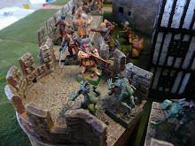The battle at the northwest tower rages, as the ghouls have finished with poor Dedrich and emerge from the gatehouse.  Gustav and his Kislevites pals bravely prepare to hold the line by protecting both rears simultaneously.