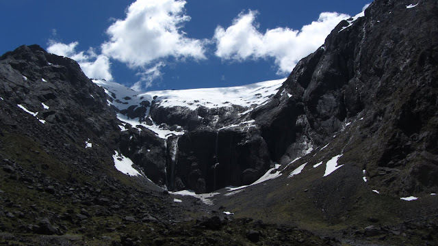 Waterfalls off a glacier melting in the summer heat.