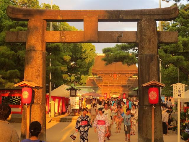 The entrance to Hakozaki shrine at sunset, during the Nagoshi-sai (summer passage rite)