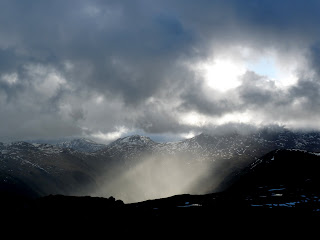 Shafts of sunlight to Honister ... looking bleak and cold