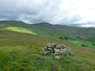 Common Fell Summit. The remote hamlet of Dowthwaitehead can be seen at the head of the valley.