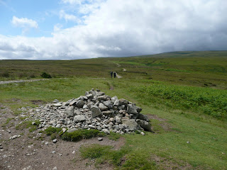 We came to a pile of stones on Askham Fell ... where we turned right to join the Roman Road of High Street. Blue sky above!!!