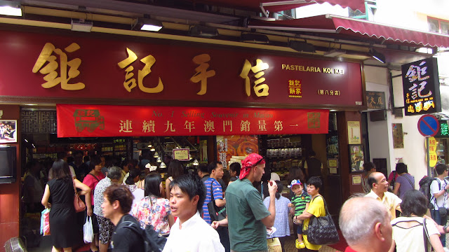 Enjoying free samples at one of Macau's famous Koi Kei bakeries.