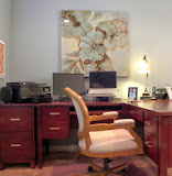 Minor Office 3 of 5 - A comfortable, feminine desk chair allows access to her computers, printer, file drawers, and desk area. The stylized floral painting is soft and graceful.