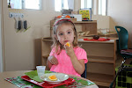 This Palos Verdes preschool girl is enjoying her snack. It's so much more fun when you are a part of the process, and not just being served by adults!
