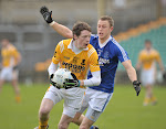 Clontibrets Conor McManus fights to keep possession from Naomh Conalls xxxin the Ulster Club Football Quarter Final game in Ballybofey. Pic Philip Fitzpatrick.