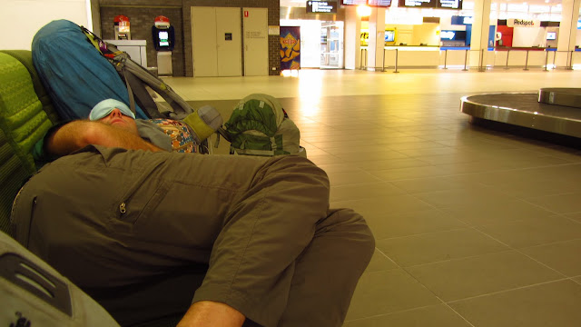 Erik having a nap at the Cairns airport.