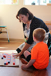 Here, our Montessori preschool teacher gives a lesson in counting, using the Montessori number rods. Most instruction is individualized and one-on-one, allowing each child to progress at his own pace.