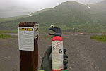 """the sign says """"CAUTION: YOU ARE NOW TRAVELLING IN BEAR COUNTRY"""".  In retrospect I should have read all the fine print.  I honestly thought they were joking at the bike store when they said I needed """"bear spray"""".  It's basically a mace super-soaker.  And I thought, what are the odds of bumping into a bear?  Pucker factor 2."""