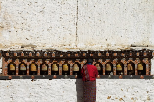 Buddhist Woman prays at a temple in Trongsa Dzong, Bhutan