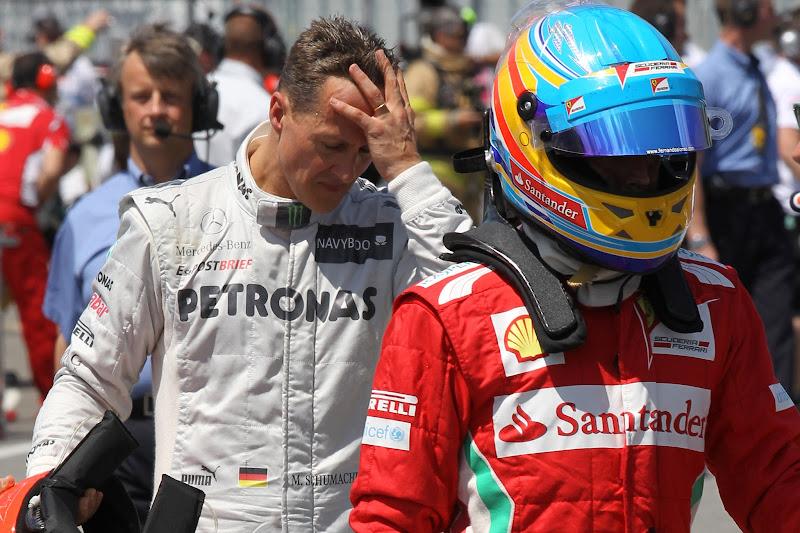 фэйспалмящий Михаэль Шумахер и Фернандо Алонсо после квалификации на Гран-при Канады 2012