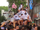 A Yamakasa team destroying their float, after the race