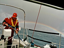 J/160 sailing offshore to US Virgin Islands- rainbow over ocean