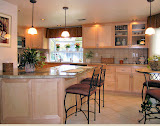 Morris Kitchen - This remodeled kitchen features beautiful new maple cabinets, granite countertops, new recessed lighting, a new breakfast bar, and additional pub seating.