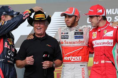 Марио Андретти на подиуме в компании других чемпионов на Гран-при США 2012