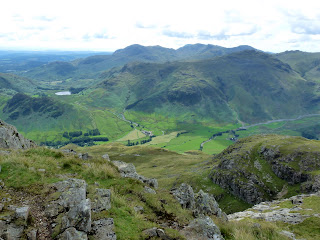 Great Langdale and Mickleden can be seen far below. The small tarn on the left of the photo is Blea Tarn.