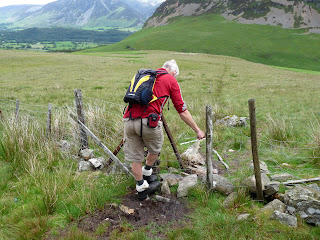 """Roger tries to repair the fence ... """"but the path goes through here"""" Ann says"""