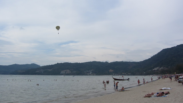 Insane parasails taking off and landing right on the beach.