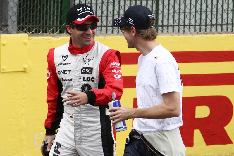 Тимо Глок и Себастьян Феттель на Гран-при Бразилии 2011
