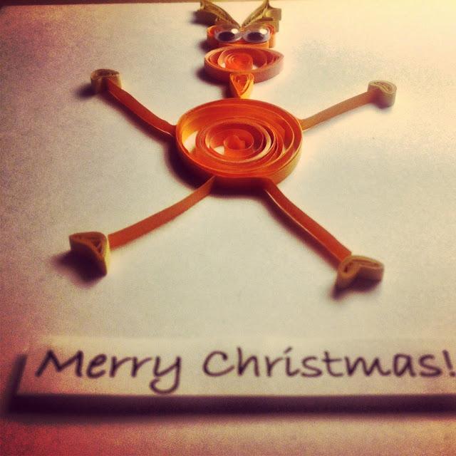 Własnoręcznie wykonana kartka świąteczna z reniferem w technice quilling .  Handmade Christmas card reindeer created quilling technique.