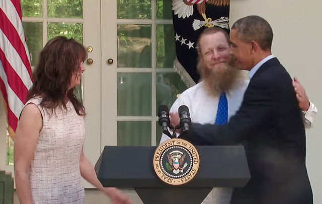 President Barack Obama embraces Bob Bergdahl, father of Bowe Bergdahl, an apparent Army deserter for whom the president traded five terrorists for with the Taliban. (White House video screen capture)