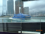 Another ferry heading to Macau with a view of Western Kowloon in the background