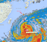 Typhoon Vongfong is due to hit Okinawa right around the time we're scheduled to fly there, for the boys' Fall break