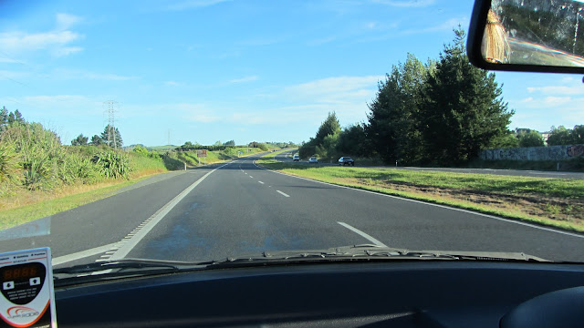 The open road south of Auckland. Our Tourism Radio unit is mounted to the left on the windshield.