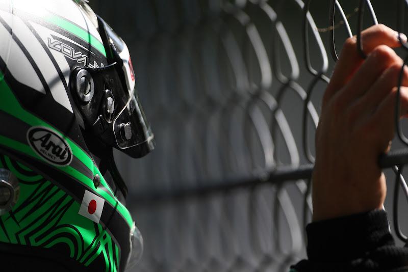 Хейкки Ковалайнен за забором на Гран-при Италии 2011 во время свободных заездов
