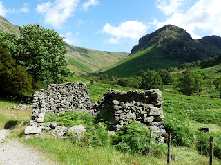 Old building and Eagle Crag.
