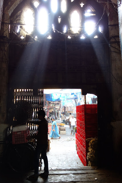 Light streaming in through one of Crawford Market's gothic arches.