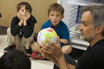 How do we make a flat map when the earth is a sphere? In this lesson, the teacher has made a world model out of paper, and shows how it covers the Montessori globe.