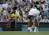 Rafael Nadal of Spain touches the court after taking a fall during a second round men's singles match against Lukas Rosol of the Czech Republic at the All England Lawn Tennis Championships at Wimbledon, England, Thursday, June 28, 2012. (AP Photo/Anja Niedringhaus)