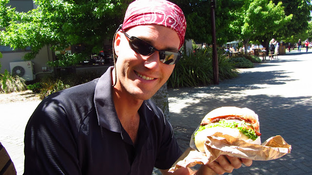 "Erik with his super-sized ""Southern Swine"" burger."