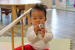 LePort Private School Irvine - Baby exploring bell at childcare center